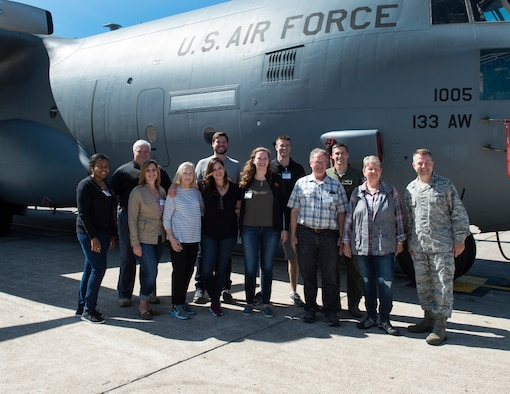 U.S. Air Force Airmen from the 133rd Airlift Wing and members of the Minnesota Congressional Delegation staff pose for a group photo in St. Paul, Minn., July 17, 2018.