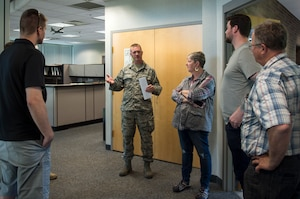 U.S. Air Force Airmen from the 133rd Airlift Wing and 148th Fighter Wing speak to members of the Minnesota Congressional Delegation staff in St. Paul, Minn., July 17, 2018.