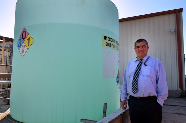 Jose Hurtado, program manager for the Air Force Civil Engineer Center's environmental restoration division, stands next to groundwater cleanup equipment located on Joint Base San Antonio-Lackland, Texas.