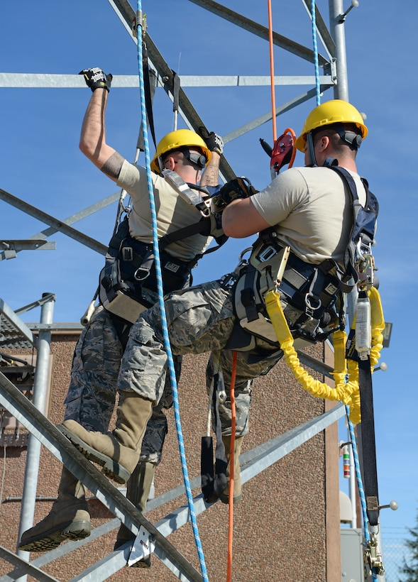 Airman 1st Class David Tran, 9th Communication Squadron cable and antenna maintainer, simulates a rescue of Senior Airman Wade Gay, 9th CS cable and antenna maintainer, Nov. 8, 2016, at Beale Air Force Base, California. Climbers must demonstrate the ability to perform a rescue as a requirement to be certified. (U.S. Air Force photo/Airman Tristan D. Viglianco)