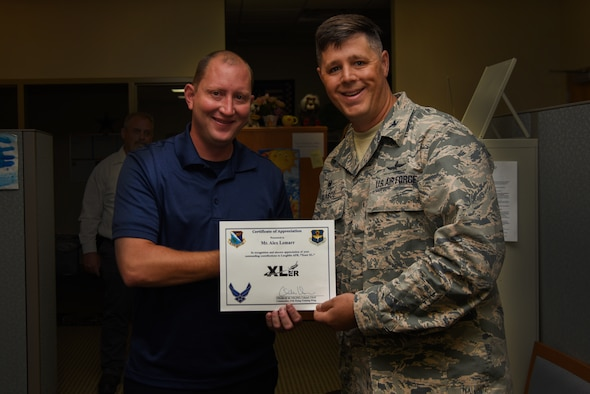 "Alex Lemarr, 47th Maintenance Directorate T-6 aircraft scheduler, was chosen by wing leadership to be the ""XLer"" of the week, for the week of July 16, 2018, at Laughlin Air Force Base, Texas. The ""XLer"" award, presented by Col. Ted Glasco, 47th Mission Support Group commander, is given to those who consistently make outstanding contributions to their unit and the Laughlin mission. (U.S. Air Force photo by Airman 1st Class Marco A. Gomez)"