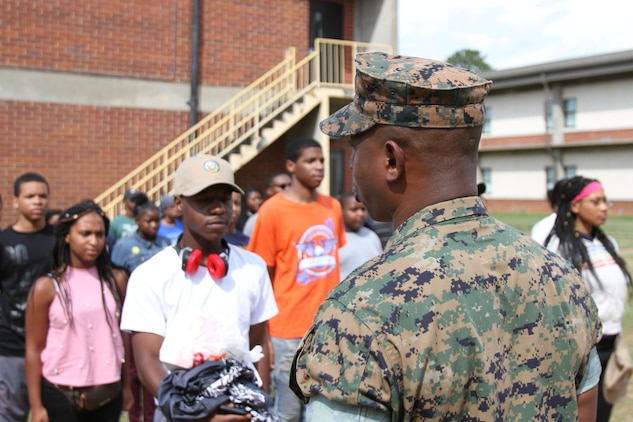 U.S. Marine Corps 1stSgt. James Williams welcomes dozens of Navy and Marine Corps Junior Reserve Officers Training Corps cadets upon arrival at Marine Corps Logistics Base Albany. More than 40 cadets spent an intense five days at MCLB Albany for its first-ever summer camp. Each cadet experienced a week-long taste of basic leadership training. (U.S. Marine Corps photo by Re-Essa Buckels)