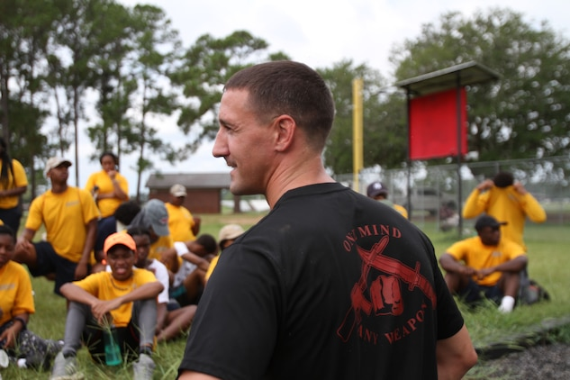 U. S. Marine Corps SSgt. James Ahearn shares information on proper techniques of the obstacle course with dozens of Navy and Marine Corps Junior Reserve Officers Training Corps cadets. More than 40 cadets spent an intense five days at Marine Corps Logistics Base Albany for its first-ever summer camp. Each cadet experienced a week-long taste of basic leadership training. (U.S. Marine Corps photo by Re-Essa Buckels)