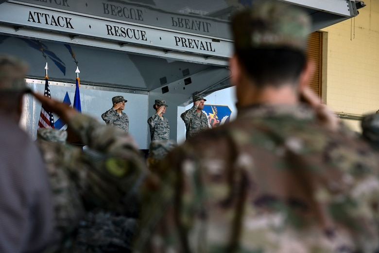 Team Moody Airmen salute during the playing of the national anthem as part of the 23d Mission Support Group's change of command ceremony, July 25, 2018, at Moody Air Force Base, Ga. The 23d MSG recognized the formal transfer of authority and responsibility as Col. Susan Riordan-Smith relinquished command to Col. Brian Stumpe. The 23d MSG is comprised of six squadrons with approximately 1,500 personnel dedicated to training, equipping and deploying personnel support forces to build, protect and sustain air bases worldwide for combat air operations. (U.S. Air Force photo by Senior Airman Greg Nash)
