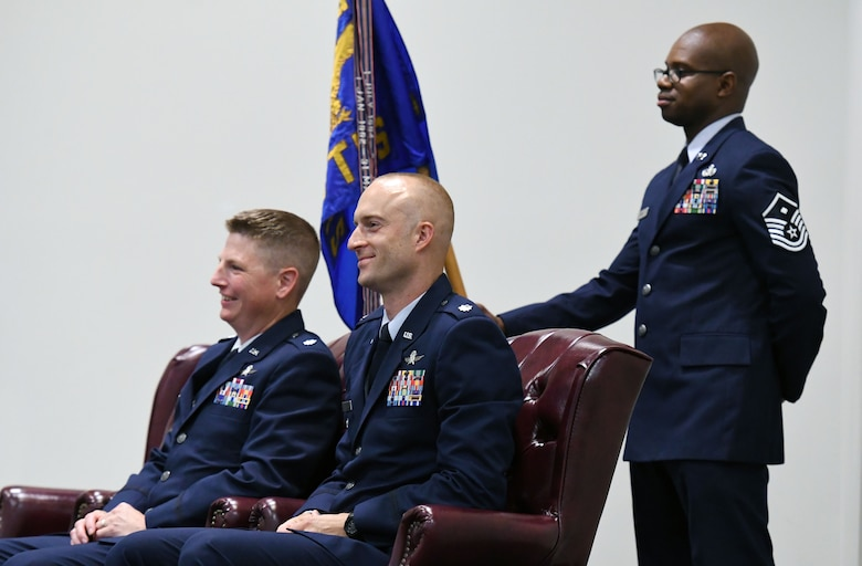 U.S. Air Force Lt. Col. Nathaniel Huston, outgoing 333rd Training Squadron commander, and Lt. Col. Andrew Miller, incoming 333rd TRS commander, sit on stage during the 333rd TRS change of command ceremony in the Roberts Consolidated Aircraft Maintenance Facility at Keesler Air Force Base, Mississippi, July 24, 2018. Miller assumed command from Huston during the ceremony. (U.S. Air Force photo by Kemberly Groue)