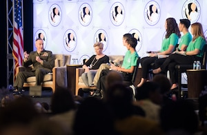 Chairman of the Joint Chiefs of Staff Marine Corps Gen. Joe Dunford and his wife, Ellyn Dunford, take part in a panel discussion.