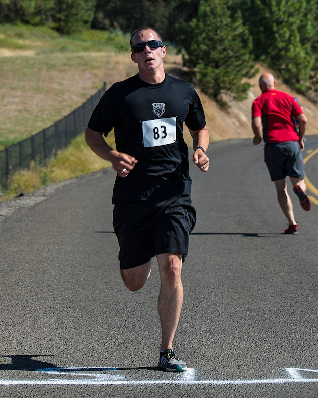 U.S. Air Force 1st Lt. Joshua Klapak, 93rd Air Refueling Squadron pilot, completes the final portion of the 14th annual Clear Lake Triathlon at Medical Lake, Washington, June 21, 2018. The print triathlon has been expertly honed to provide a physically challenging and well-charted course. (U.S. Air Force photo/ Airman 1st ClassWhitney Laine)