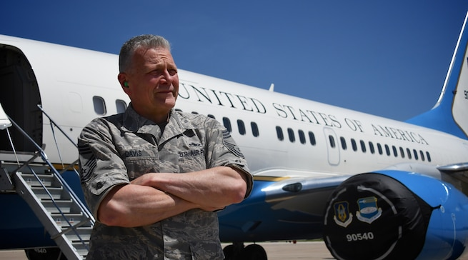 """Ready to serve and keep the flying mission on track, Chief Master Sgt. John Davis knows jets and their engines. When Davis isn't at the 932nd Maintenance Group, helping train new reservists on C-40 jet engines, he is an assistant professor of aviation technology at Purdue University. The two positions complement each other.  During his 15 years on active duty, Davis worked on engines powering F-4 Phantoms, F-15 Eagles, C-130s, and a variety of other Air Force aircraft while he was assigned to Edwards Air Force Base, Calif. He was an instructor at Chanute Air Force Base in Illinois for eight years and taught courses in airframe and power plant. Davis joined the Air Force in 1978 and said he plans to continue serving at the 932nd Maintenance Group as a traditional reservist. """"I still love what I'm doing,"""" he said.  (U.S. Air Force photo by Lt. Col. Stan Paregien)"""