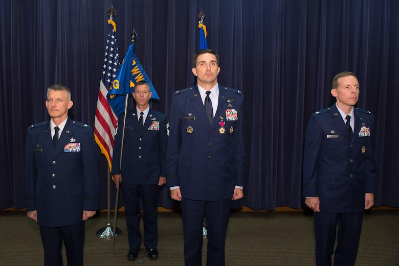 1st Weather Group (WXG) leadership prepare to transfer the group's guidon during a change of command ceremony July 24, 2018, at Offutt Air Force Base, Nebraska. 1st WXG weather forecast products protect more than two million military personnel, their families and almost a trillion dollars in DOD assets around the world. (U.S. Air Force photo by Paul Shirk)