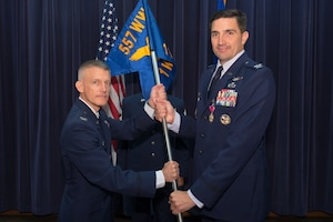 U.S. Air Force Col. Thomas Blazek, 1st Weather Group (WXG) commander, relinquishes command of the 1st WXG to U.S. Air Force Col. Brian Pukall, 557th Weather Wing commander, during a change of command ceremony July 24, 2018, at Offutt Air Force Base, Nebraska. Blazek will be retiring from the Air Force after 27 years of service. (U.S. Air Force photo by Paul Shirk)