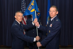 U.S. Air Force Col. Travis Steen, 1st Weather Group (WXG) commander, assumes command of the 1st WXG from U.S. Air Force Col. Brian Pukall, 557th Weather Wing commander, July 24, 2018, at Offutt Air Force Base, Nebraska. Steen was previously assigned to Offutt AFB from 1999-2002 and was the officer in charge of radar meteorology applications when the 557th WW was still the Air Force Weather Agency. (U.S. Air Force photo by Paul Shirk)