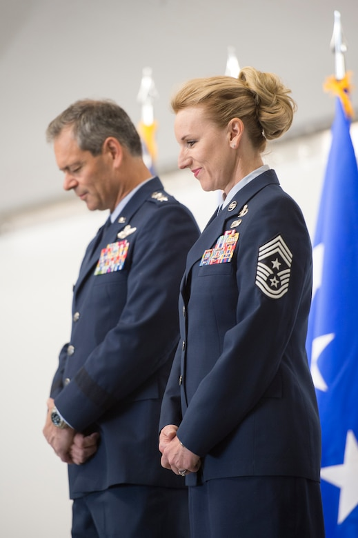 Friends, family, colleagues, and invited guests attend the retirement ceremony for Air Force Chief Master Sgt. Gay L.C. Veale, held at Hangar 1, Joint Base Elmendorf-Richardson, Alaska, July 20, 2018. Chief Veale retired after 30 years of exemplary and faithful service.