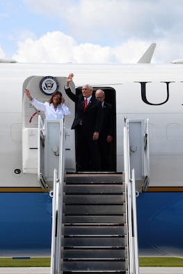 Vice President of the United States Michael Pence and his wife, Karen Pence, second lady of the United States, egress the C-32 Air Force Two July 25, 2018, on Grand Forks Air Force Base, North Dakota. Mrs. Pence sat down with spouses of Airmen to discuss quality of life improvements, and the vice president learned more about the Airmen of Grand Forks AFB and the RQ-4 Global Hawk mission before thanking a crowd of Airmen. (U.S. Air Force photo by Airman 1st Class Elora J. Martinez)