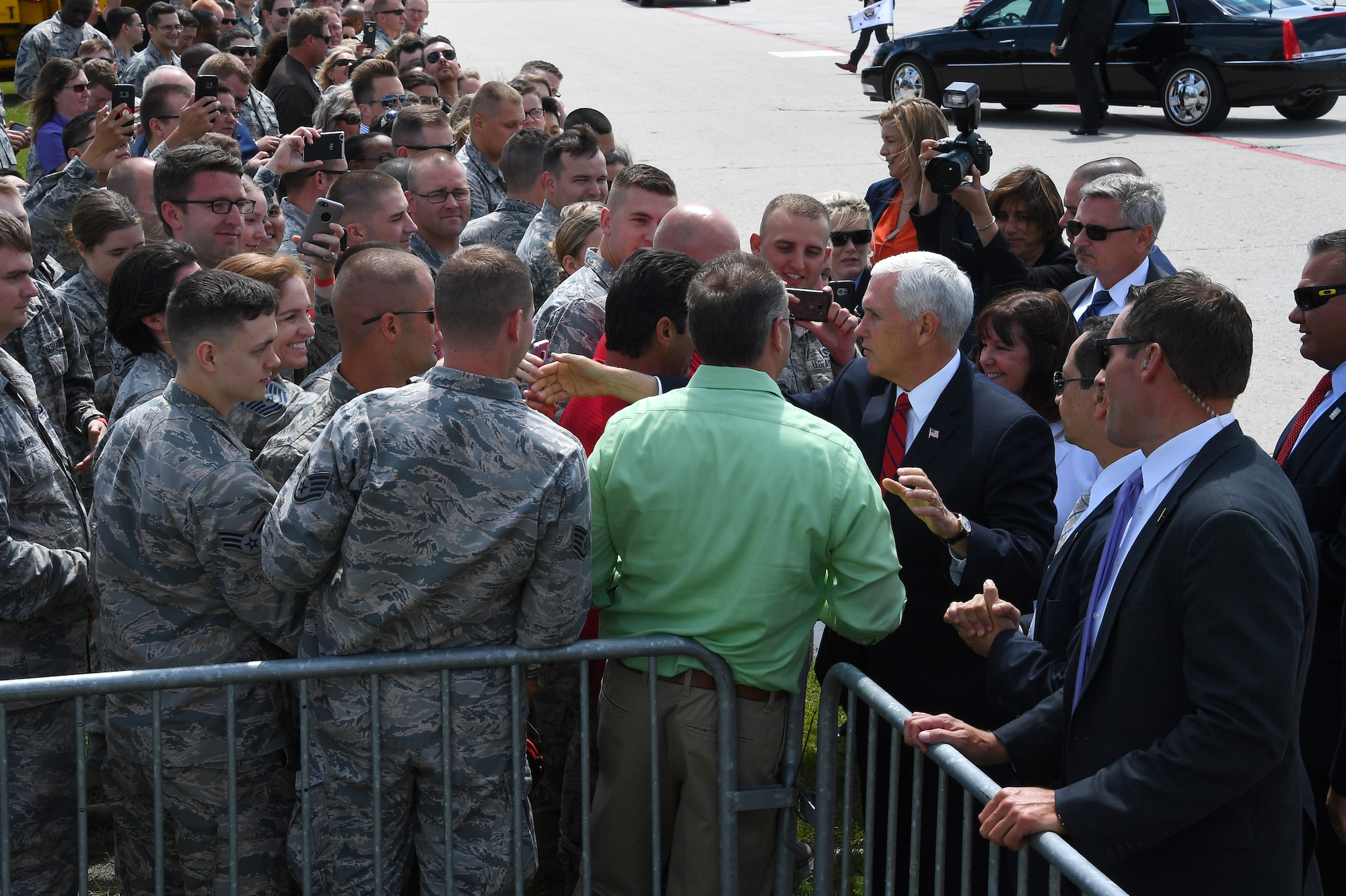 Vice President of the United States Michael Pence reaches out to shake hands with several Airmen July 25, 2018, after arriving to Grand Forks Air Force Base, North Dakota. During his visit, Pence was able to get a glimpse into some of the Grand Forks AFB missions, to include worldwide intelligence, surveillance and reconnaissance using the RQ-4 Global Hawk. (U.S. Air Force photo by Airman 1st Class Elora J. Martinez)