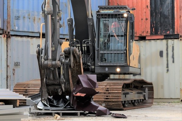 A participant in this year's Overseas Contingency Operations Readiness Training uses heavy equipment to properly dispose of unused equipment June 19 at Fort Custer, Michigan. The training consisted of 62 attendees with half of them being civilians and the other half military reservists from the Navy, Army and Air Force assigned to DLA Disposition Services. Photo by Air Force Master Sgt. J. Scott Mathews.