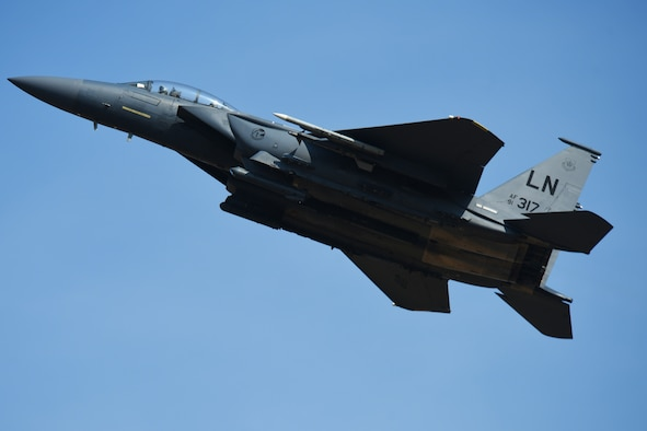 An F-15E Strike Eagle assigned to the 492nd Fighter Squadron flies over Royal Air Force Lakenheath, England during a surge operation, July 25. During surge operations, aircrew enter engagements with opposing aircraft from beyond visual range, and continuously calculate the closing distance to determine the proper tactic to employ once the opposing aircraft enters view.  (U.S. Air Force photo/Airman 1st Class Christopher S. Sparks)