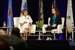 Navy Vice Adm. Raquel C. Bono, director of the Defense Health Agency, and Stacy Cummings, program executive officer for Defense Health Management Systems, answer questions about the progress of MHS GENESIS electronic health record, during the 2018 Defense Health Information Technology Symposium in Orlando, Fla., July 24, 2018. DoD photo