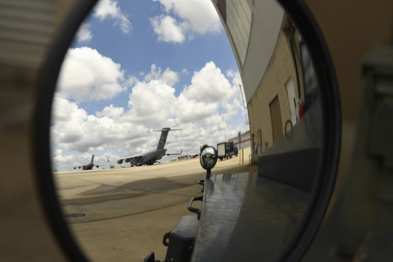 Members of the 145th Aircraft Maintenance Squadron (AMXS) prepare to tow a C-17 Globemaster III aircraft at the North Carolina Air National Guard Base, Charlotte Douglas International Airport, July 24, 2018. Since the aircraft conversion in April, the 145th AMXS is working to train maintenance personnel with a goal of them being fully qualified.