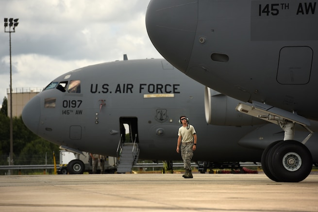 U.S. Air Force Senior Airmen Zackary Aldag, 145th Aircraft Maintenance Squadron, walks to the front of a C-17 Globemaster III at the North Carolina Air National Guard Base, Charlotte Douglas International Airport, July 24, 2018. Aldag is in upgrade training for C-17 Globemaster III aircraft after the units conversion from the C-130 Hercules aircraft and is working towards being fully qualified.