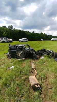 Wreckage from a vehicle litters the median of Interstate-49 after an accident outside Opelousas, Louisiana, May 24, 2018.  The vehicle hit a semitractor trailer going northbound. The driver, Jason Hesni, sustained life-threatening injuries. U.S. Air Force Chief Master Sgt. Shelley Cohen, 307th Bomb Wing command chief, happened upon the scene, administering first-aid and saving Hesni's life. (courtesy photo)