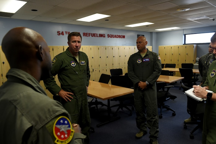 U.S. Air Force Maj. Gen. Patrick Doherty, 19th Air Force commander, visits with several members from the 54th Air Refueling Squadron at Altus Air Force Base, Oklahoma, July 17, 2018.