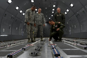 U.S. Air Force Chief Master Sgt. David Brown, 19th Air Force command chief, inspects the KC-46 Fuselage Trainer with members from the 97th Air Mobility Wing at Altus Air Force Base, Oklahoma. July 17, 2018.