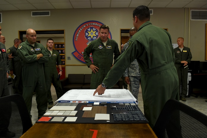 U.S. Air Force Maj. Gen. Patrick Doherty, 19th Air Force commander, visits with leadership from the 58th Airlift Squadron about renovations that are scheduled within the next year at Altus Air Force Base, Oklahoma, July 17, 2018.