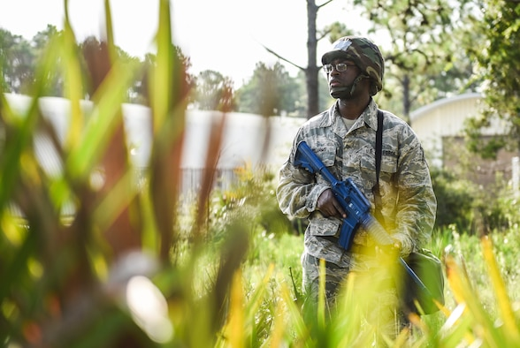 U.S. Air Force Tech. Sgt. Jean-Paul Williams, a Silver Flag training site student from the 168th Force Support Squadron, Eielson Air Force Base, Alaska, keeps watch over a building at the Silver Flag training site on Tyndall Air Force Base, Florida, July 19, 2018.
