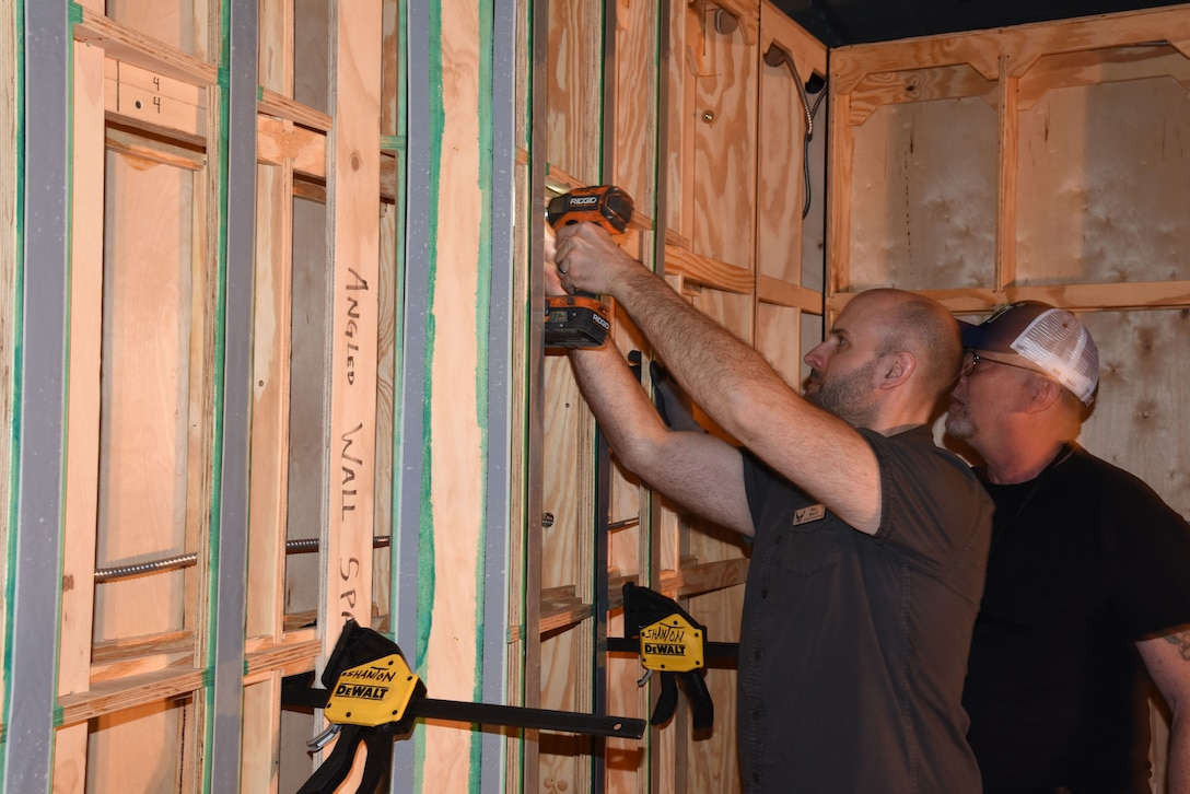 Museum Exhibit Specialists Will Haas(L) and Rick Brewer(R) install wall sections for the Memphis Belle Exhibit in the WWII Gallery. (U.S. Air Force photo by Ken LaRock)