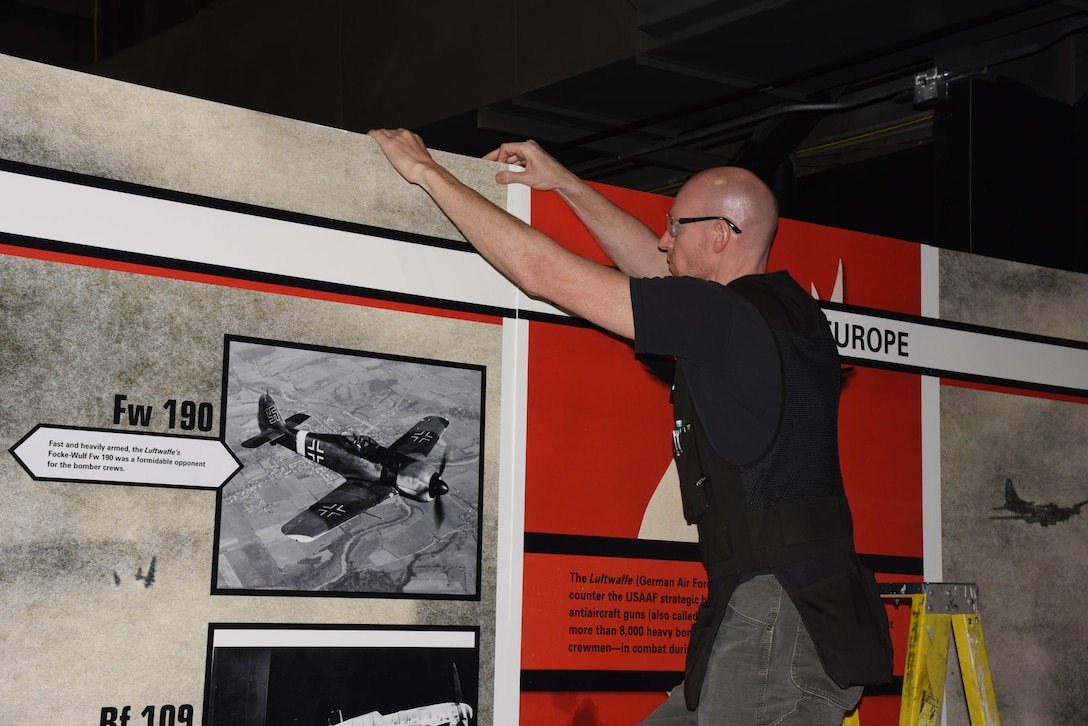 Museum Exhibits Specialist Shane Stanton prepares a wall panel for display in the WWII Gallery. (U.S. Air Force photo by Ken LaRock)