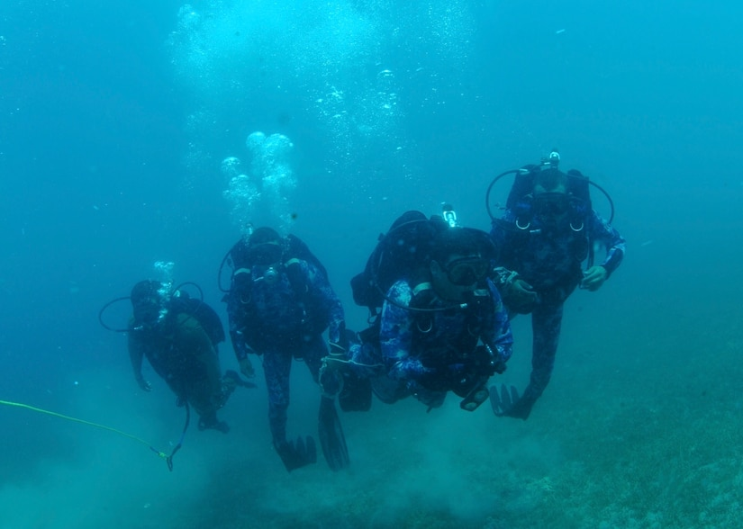 An American sailor deployed to U.S. 5th Fleet's Task Group 52.3, left, and Egyptian sailors conduct a familiarization dive during Exercise Eagle Response 18 at Red Sea Naval Base, Egypt, July 25, 2018. Eagle Response 18 is an explosive ordnance disposal and diving exercise conducted with the Egyptian navy to enhance interoperability and warfighting readiness, fortify military-to-military relationships and advance operational capabilities of all participating units. Navy photo