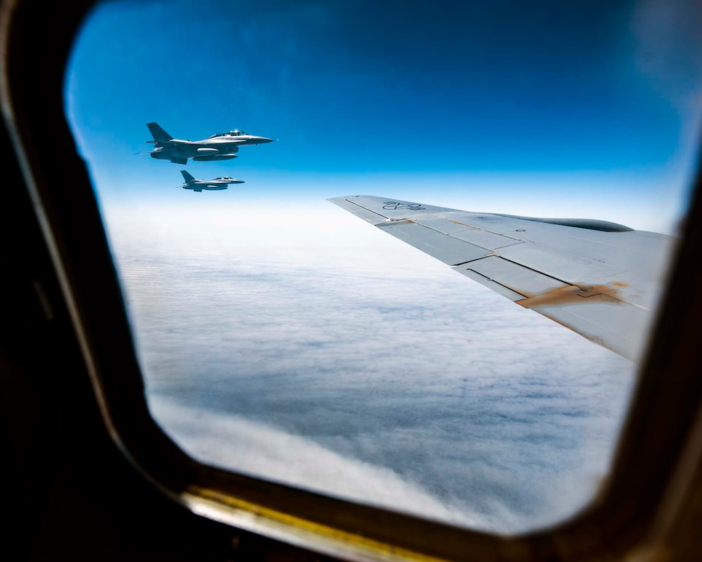 Two F-16D Fighting Flacons from the 162nd Fighter Wing in Tucson, Ariz. can be seen practicing air-intercept procedures from the window of a KC-135 Stratotanker from the 141st Air Refueling Wing over western Oregon during the Aerospace Control Alert CrossTell training exercise July 24, 2018. CrossTell is a three-day exercise involving multiple Air National Guard units, the Civil Air Patrol, and U.S. Coast Guard rotary-wing air intercept units to conduct training scenarios to replicate airborne intercepts designed to safely escort violators out of restricted airspace. (U.S. Air National Guard photo by Staff Sgt. Rose M. Lust)