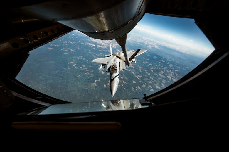 An F-15A Eagle from the 142nd Fighter Wing in Portland, Ore. approaches a KC-135 Stratotanker to refuel during the Aerospace Control Alert CrossTell exercise July 24, 2018 over western Oregon. CrossTell is a three-day exercise involving multiple Air National Guard units, the Civil Air Patrol, and U.S. Coast Guard rotary-wing air intercept units to conduct training scenarios to replicate airborne intercepts designed to safely escort violators out of restricted airspace. (U.S. Air National Guard photo by Staff Sgt. Rose M. Lust)
