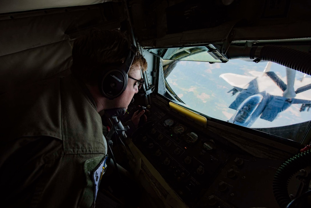 Staff Sgt. Chas Cramer, a boom operator with the 116th Air Refueling Squadron, transfers fuel to an F-15A Eagle from the 142nd Fighter Wing during Aerospace Control Alert CrossTell training exercise July 24, 2018 over western Oregon. CrossTell is a three-day exercise involving multiple Air National Guard units, the Civil Air Patrol, and U.S. Coast Guard rotary-wing air intercept units to conduct training scenarios to replicate airborne intercepts designed to safely escort violators out of restricted airspace. (U.S. Air National Guard photo by Staff Sgt. Rose M. Lust)