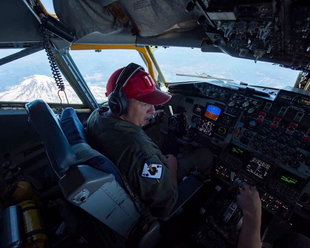 Capt. Jon Cael, a pilot from the 141st Air Refueling Wing, chats with the co-pilot as the tanker passes by Mt. Rainier during Aerospace Control Alert CrossTell training exercise July 24, 2018. The tanker flew to western Oregon to support F-16 Fighting Falcons and F-15 Eagles participating in the exercise. CrossTell is a three-day exercise involving multiple Air National Guard units, the Civil Air Patrol, and U.S. Coast Guard rotary-wing air intercept units to conduct training scenarios to replicate airborne intercepts designed to safely escort violators out of restricted airspace. (U.S. Air National Guard photo by Staff Sgt. Rose M. Lust)