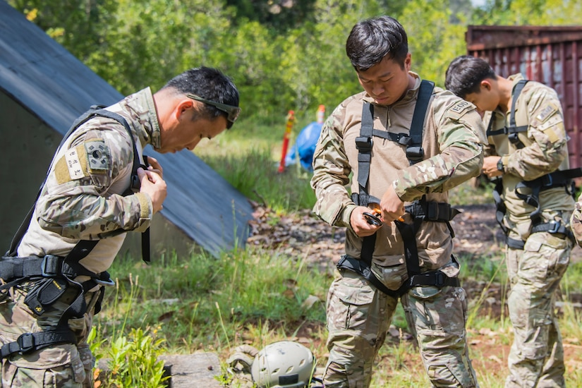 Members of the Korean Special Warfare Brigade, Explosive Ordnance Disposal Unit 1, gear up in preparation to conduct rappelling training at Joint Base Pearl Harbor-Hickam, Hawaii.
