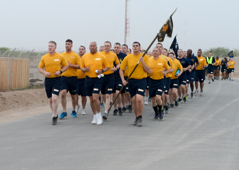 Sailors deployed to Camp Lemonnier, Djibouti, participate in an early morning group run as part of Chief Petty Officer 365 training.