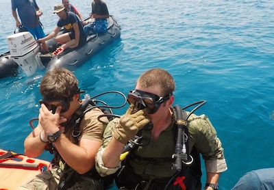 Sailors deployed to U.S. 5th Fleet's Task Group 52.3 prepare to depart a boat  during a familiarization dive with the Egyptian Naval Force (ENF) during Eagle Response 18. Eagle Response 18 is an explosive ordnance disposal and diving exercise with the ENF conducted to enhance interoperability and war-fighting readiness, fortify military-to-military relationships and advance operational capabilities of all participating units. (U.S. Navy photo by Lt. Chloe Morgan/Released)