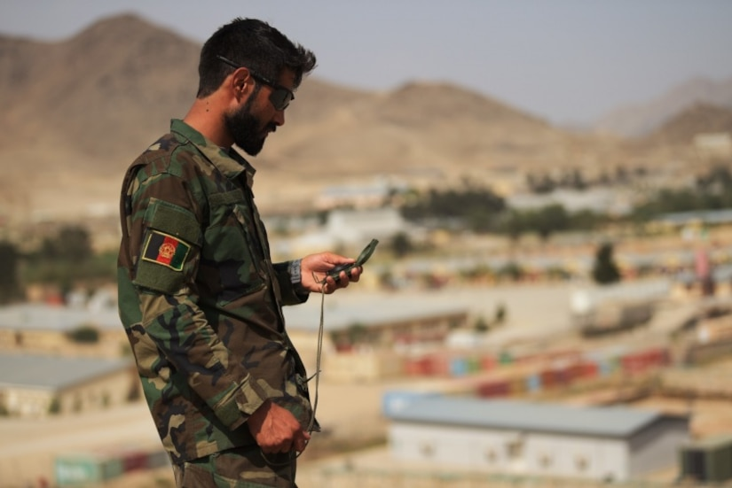 An ANASOC Commando Tactical Air Coordinator (TAC) checks his compass before moving to verify plotted grids during specialized land navigation training near Kabul, Afghanistan, Jul. 16, 2018. Throughout the training, Commandos used different communications platforms to communicate with overhead aircraft during their missions, replicating battlefield scenarios. This multi-faceted communications approach enables Commandos to orchestrate kinetic close-air strikes and casualty evacuation with surgical precision.