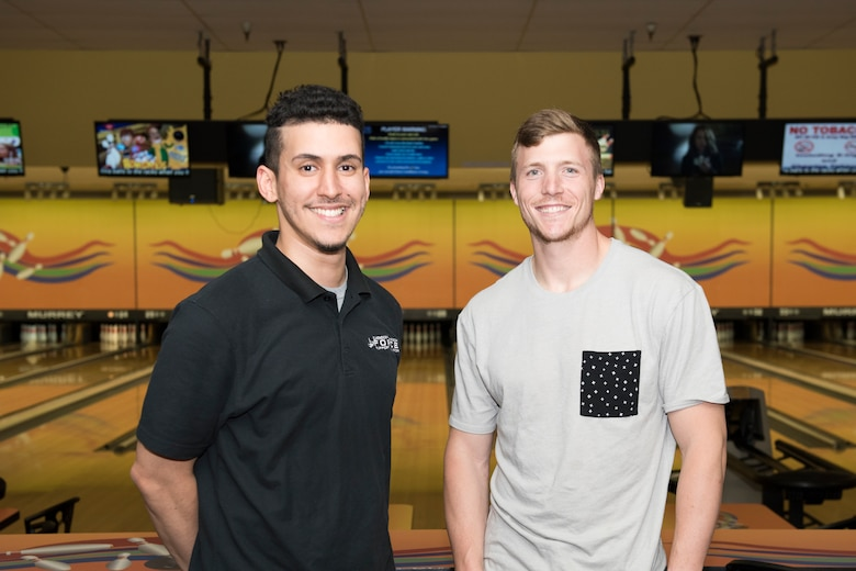 Staff Sgt. Chase McFeron, a 673d Civil Engineer Squadron explosive ordnance disposal craftsman, (right) and Luis Ruiz, Polar Bowl cashier, pose for a photo at the bowling alley at Joint Base Elmendorf-Richardson, Alaska, July 13, 2018. McFeron performed the Heimlich maneuver on Ruiz when he was choking on a piece of steak.