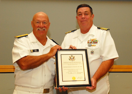 Retired Navy Rear Adm. John King (left), stands with retiring Navy Capt. Daniel Hodgson during a retirement ceremony July 20. Hodgson, who last served as the director of DLA Troop Support's C&E supply chain, retired after 27 years.