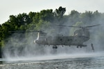 In this image, released by the U.S. Army Reserve, members of the 420th Engineer Brigade conduct a helocast drop in the Arkansas River July 22, 2018, as part of River Assault 2018, a joint training exercise featuring assets from the Army Reserve, National Guard, and active Army. This helocast event was supported by members of the Sapper Leader Course and the U.S. Army Deep Sea Dive Team. (U.S. Army Reserve Photo by First Sgt. Daniel Griego/Released)