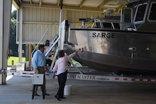 "Ms. Doris Sema, wife of former Irvington Site employee Stephen Sema, christens the ""Sarge"", a surveying vessel named after her husband during a christening ceremony July 13, 2018, in Irvington, Ala."
