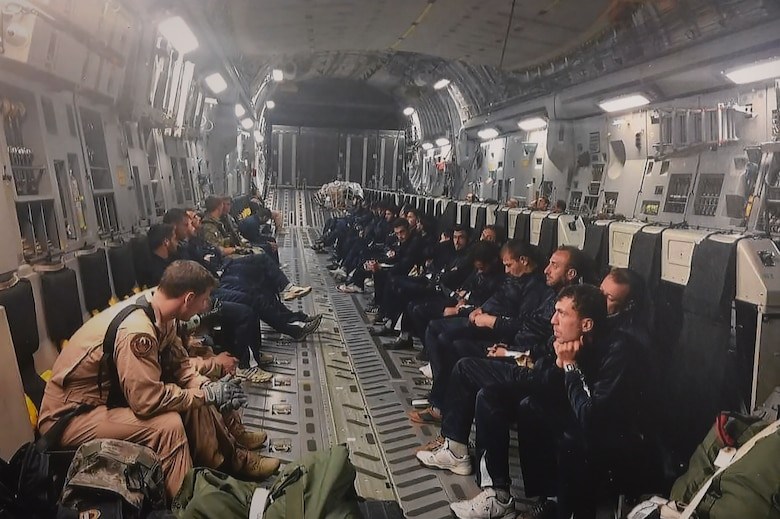 (Now) Master Sgt. Brady Brammer, unaccompanied housing superintendent, front left, flies in a C-17 Globemaster III to Jordan along with members of the Syrian Revolutionary and Opposition Forces, in 2015. At the time, Brammer was actively completing missions across the world as a Phoenix Raven team member. (U.S. Air Force photo by Airman 1st Class Elora J. Martinez)