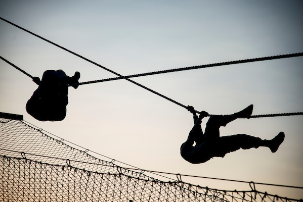 Security Forces Airmen descend a rope July 23, 2018, at Joint Base San Antonio-Camp Bullis, Texas in preparation for the 2018 Defender Challenge. The competition will pit security forces teams against each other in realistic weapons, dismounted operations and relay challenge events. (U.S. Air Force photo by Senior Airman Stormy Archer)