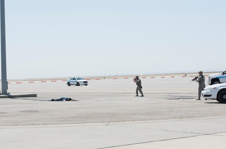 Members of the 366th Security Forces squadron prepare to apprehend Airman 1st Class Trevor Gordnier, 366th Fighter Wing broadcast journalist, during a Force Protection Condition exercise, July 23, 2018, at Mountain Home Air Force Base, Idaho. The exercise tested the wing's ability to execute the proper procedures associated with different FPCONs during a wide variety of scenarios. (U.S. Air Force photo by Airman 1st Class Alaysia Berry)
