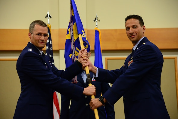 Maj. Frank Schiavone, right, accepts command of the 341st Contracting Squadron from Col. Marcus Glenn, 341st Mission Support Group commander, during an assumption of command ceremony July 26, 2018, at the Grizzly Bend at Malmstrom AFB, Mont.