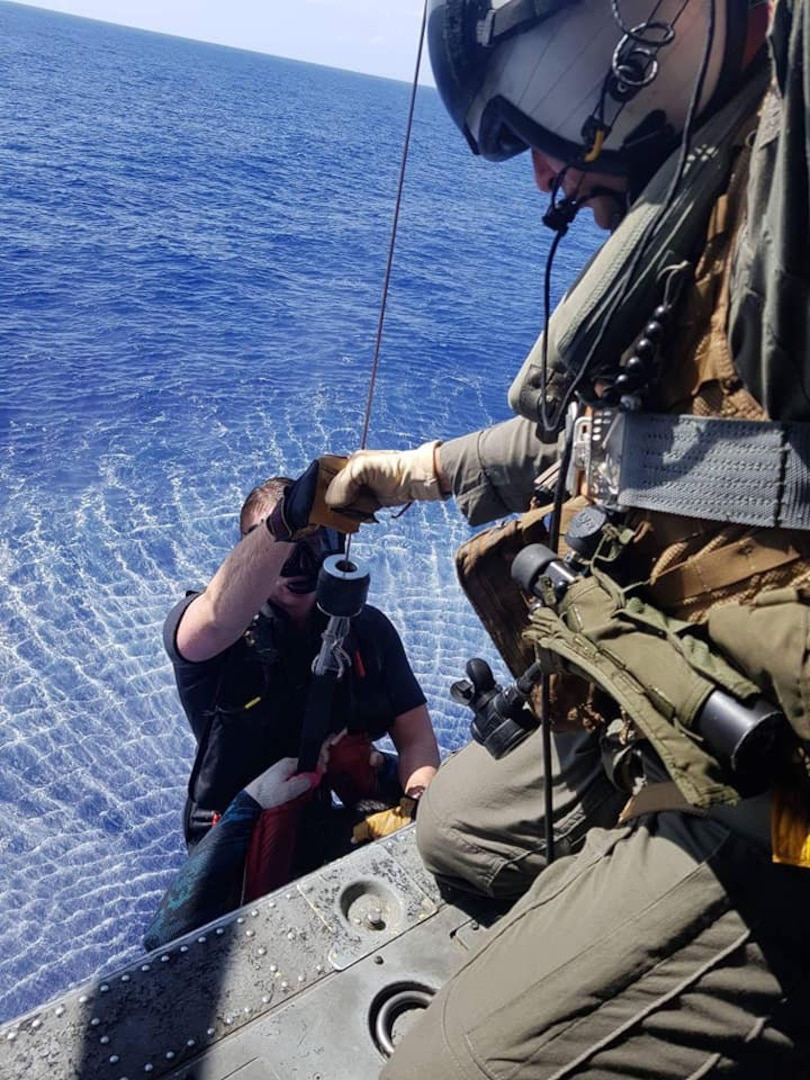 """PACIFIC OCEAN (July 26, 2018) -- Sailors assigned to the Guam-based """"Island Knights"""" from Helicopter Sea Combat Squadron (HSC) 25 rescue divers separated from their boat more than 15 miles from the Guam shore."""
