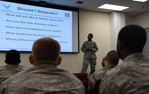 Airmen assigned to the 8th Fighter Wing attend a Palace Chase and Palace Front brief at Kunsan Air Base, Republic of Korea, July 19, 2018. U.S. Air Force Master Sgt. Venita Miles, Pacific Air Forces in-service recruiter traveled to the Korean peninsula to educate Airmen on transitioning from active-duty to the reserves.
