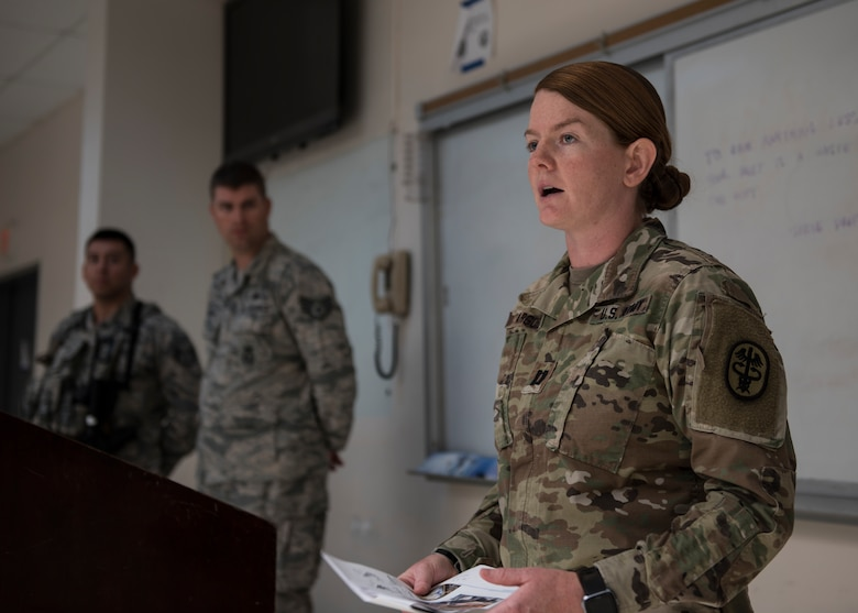 U.S. Army Capt. Alexandria Argue, 39th Medical Group veterinarian, briefs members of the 39th Security Forces Squadron during guard mount at Incirlik Air Base, Turkey, July 26, 2018.